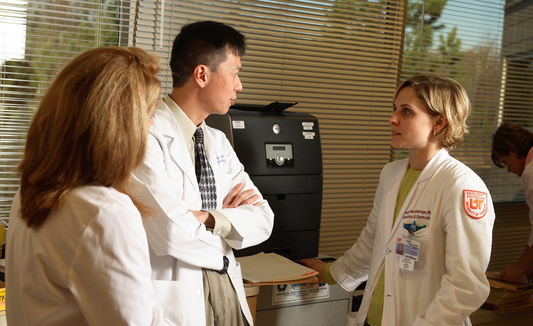 Gynecologic oncologist confers with nurse practioners